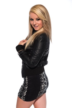 Petite young blonde in a black leather jacket photo