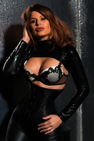 Beautiful tall brunette dressed in black latex photo