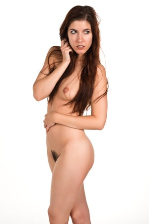 Pretty slender redhead posing nude
