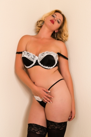 Curvy young blonde in black and white lingerie photo