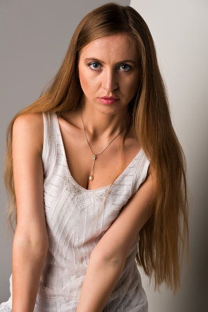Pretty young Russian blonde in a white sleeveless top