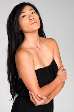 strapless: Pretty young Filipina in a strapless black dress