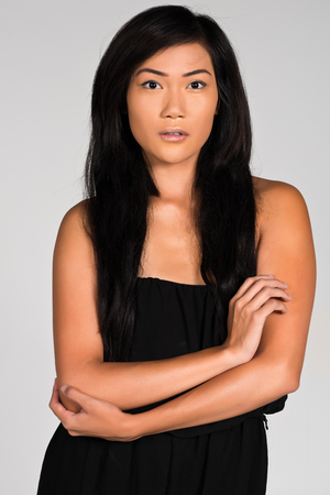 filipina: Pretty young Filipina in a strapless black dress