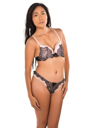 Pretty Filipino woman dressed in mauve lingerie photo