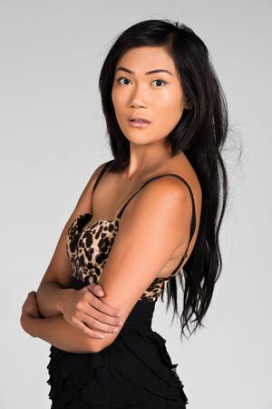 Pretty Filipino woman in a leopard print and black dress photo