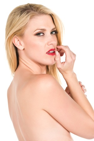 Beautiful young topless blonde on white photo