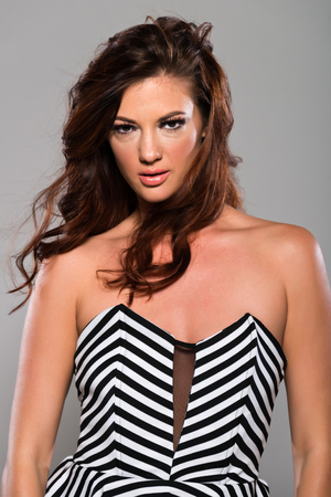 strapless: Beautiful slender brunette in a striped strapless top