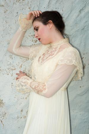 Pretty brunette in a vintage Victorian dress photo