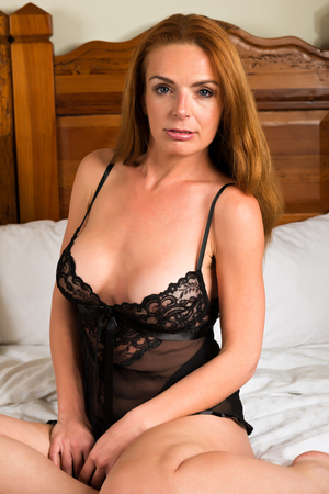 chemise: Beautiful tall redhead in a black chemise