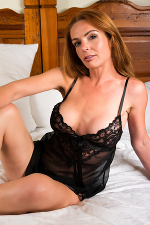 redhead lingerie: Beautiful tall redhead in a black chemise