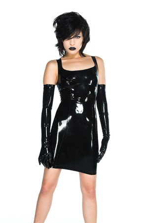 latex girl: Tall slender woman dressed in black latex Stock Photo