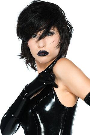 short gloves: Tall slender woman dressed in black latex Stock Photo