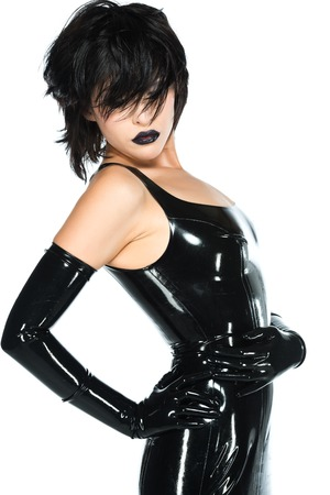 black gloves: Tall slender woman dressed in black latex Stock Photo