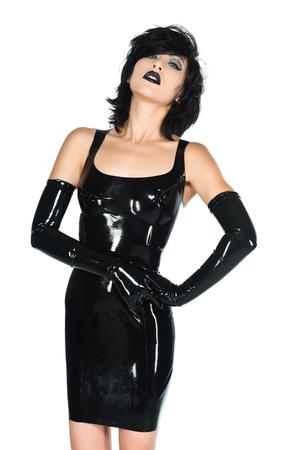Tall slender woman dressed in black latex photo