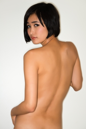 Beautiful young nude Japanese woman photo