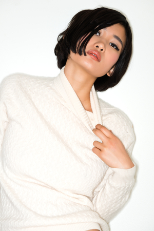 Beautiful young Japanese woman in a white knit sweater Stock fotó - 24284543