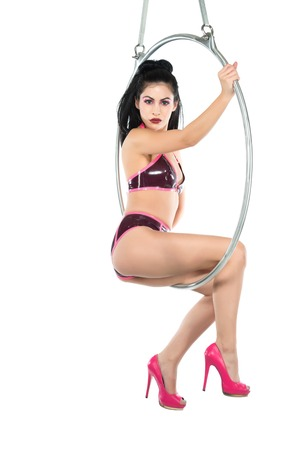 shiny black: Tall slender woman suspended from an aerial hoop
