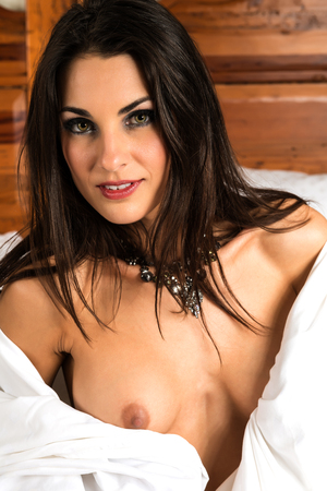 Beautiful Czech brunette nude in bed photo