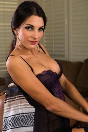 Beautiful slender Czech brunette in a purple bodysuit photo