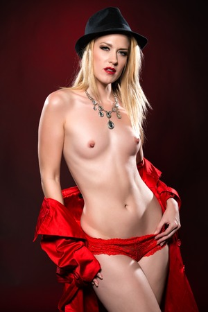 Beautiful slender blonde woman in a red raincoat Stock Photo - 24735842