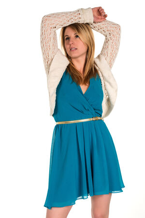 Pretty young blonde woman in a turquoise dress photo