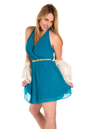 Pretty young blonde woman in a turquoise dress