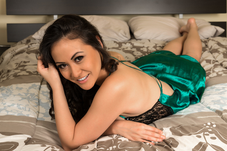 negligee: Beautiful multiracial woman in a green and black negligee