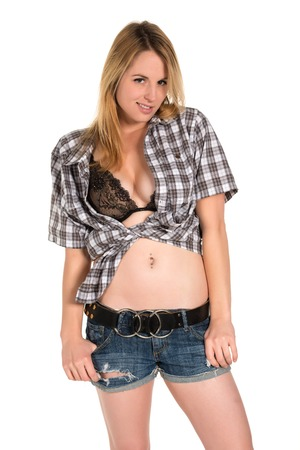 Pretty young blonde in a plaid shirt photo