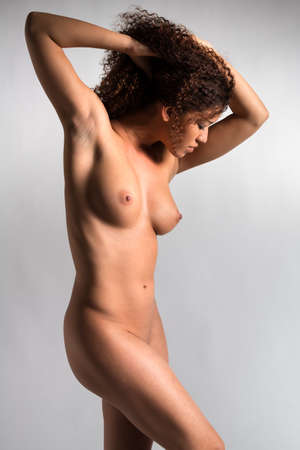 nude: Beautiful nude wavy haired multiracial woman