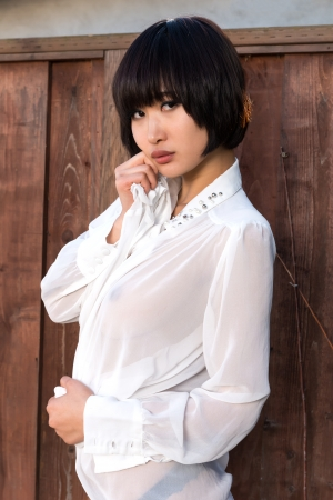 Beautiful young Japanese woman in a sheer blouse Banco de Imagens
