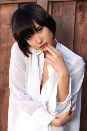 Beautiful young Japanese woman in a sheer blouse photo