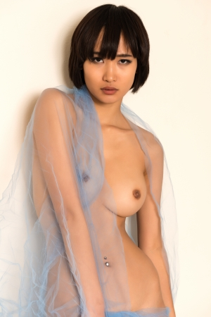 Beautiful young Japanese woman wrapped in blue tulle
