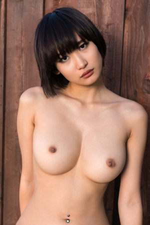 nude: Beautiful young Japanese woman nude against a wood fence Stock Photo