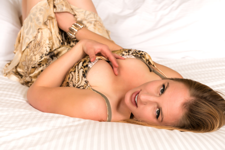 Pretty young blonde woman in a print dress photo