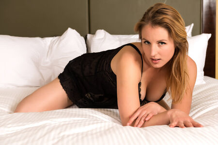 chemise: Pretty young blonde woman in a black chemise