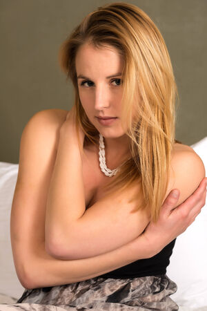 Pretty young blonde woman in a long dress photo