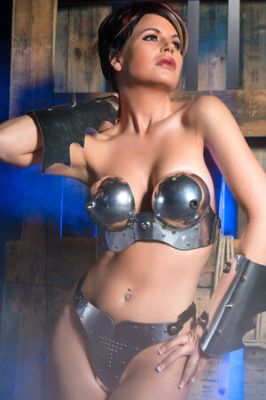 Beautiful brunette dressed as a fantasy warrior photo