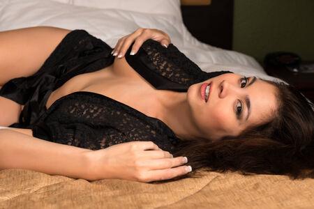 Beautiful young Eurasian woman sexy in a black robe photo