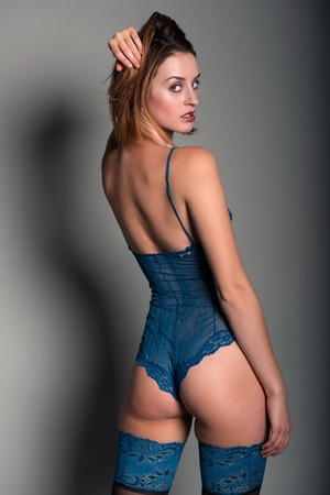 redhead lingerie: Tall young redhead in a turquoise bodysuit