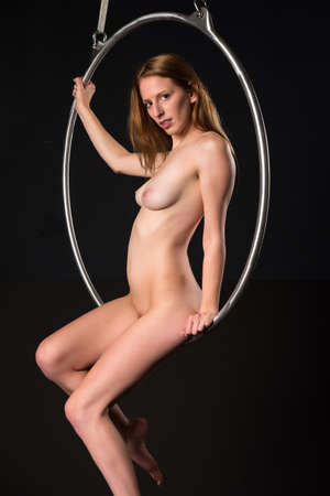 nude blonde woman: Pretty young nude blonde woman on an aerial ring