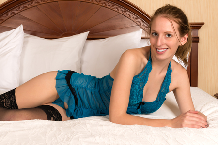 chemise: Pretty young blonde woman in a blue chemise