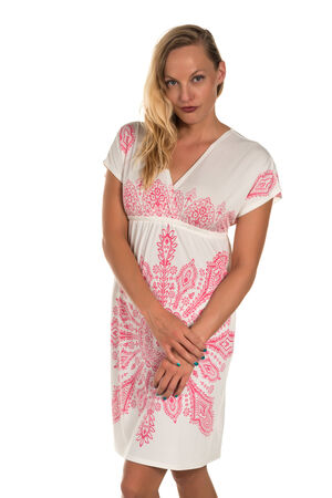 Pretty blonde woman in a pink and white dress photo