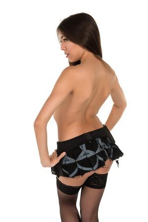Beautiful petite Eurasian woman in black lingerie photo