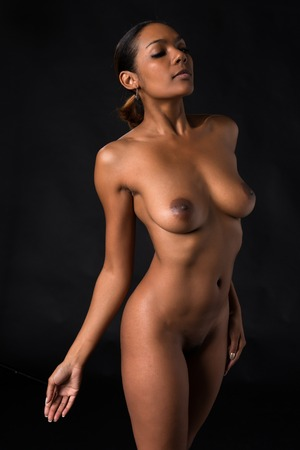 naked african: Beautiful young multiracial woman nude on black