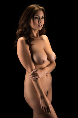 asia nude: Beautiful young Eurasian woman nude in shadow
