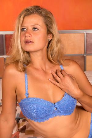 blue lingerie: Beautiful statuesque blonde woman in blue lingerie