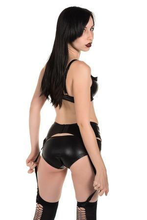 garters: Beautiful pale goth girl in black lingerie Stock Photo
