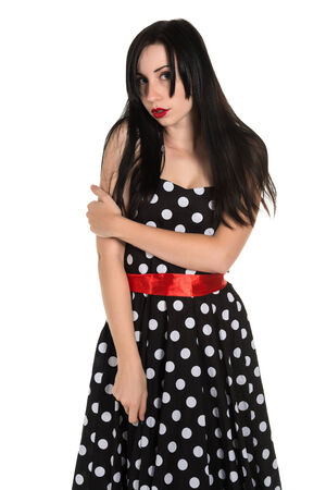 Pretty black haired woman in a polka dot dress photo