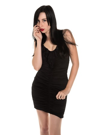 Pretty black haired woman in a black party dress