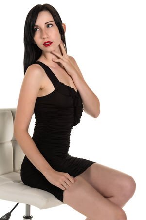 stool: Pretty black haired woman in a black party dress